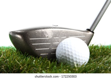 Golf club ready to hit golf ball on white background
