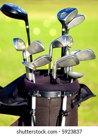 golf clubs in a bag with a course in the background