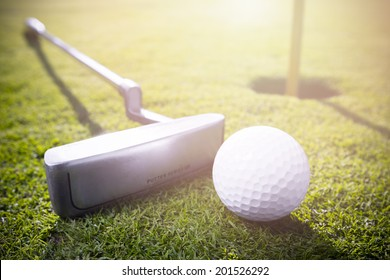 a golf clubs and golf balls in the grass