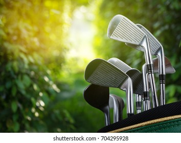 Golf clubs drivers over green background