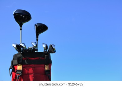 Golf Clubs in a Red Bag, putter, irons, driver and 3 wood,vertical, copy space