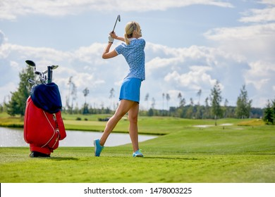 Golf course, a beautiful girl getting ready to hit the ball. Lifestyle concept, golf concept, pursuit of excellence, craftsmanship, royal sport, sports banner.