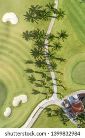 Golf course birds eye view of fairway golfing green sand pits lawn road house  path no people copy space
