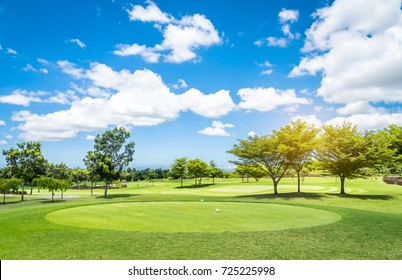 Golf course with blue sky background.