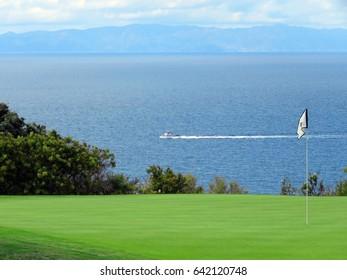 Golf Course Boat in Ocean