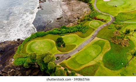 Golf course is bordered by the sea, the top view