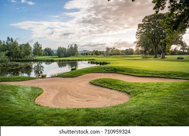 Golf course with bunker, lake and green