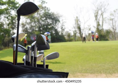 Golf Course with Golf Carts on Sunny Day