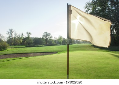 Golf course detail with the white flag in front