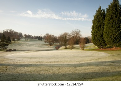 A golf course drapped in winter frost in the UK.