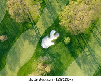Golf course. Eye bird view from the sky. Aerial photograph of forest and golf course.
