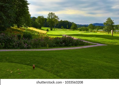 Golf course with flower and path. Europe