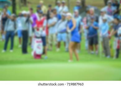 Golf course and green grass blur background.