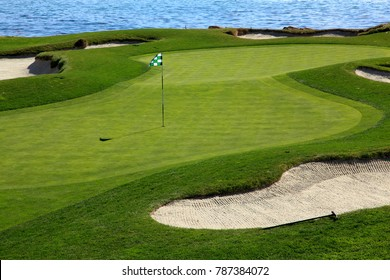 Golf course green with ocean background