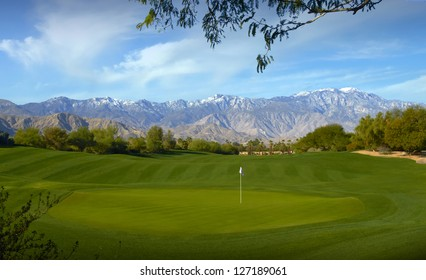 Golf Course with Greens and mountains