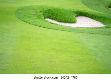 Golf course with a heart-shaped sand pit.