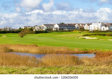 Golf course with lake and sand in Galway, Ireland