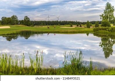 golf course landscape with beautiful lake at summer day