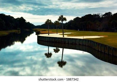 Golf course next to the pond. More with keyword group12a