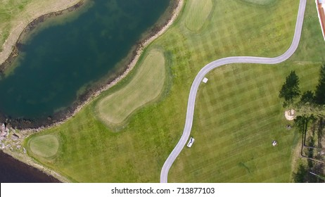 Golf course on a Sunny day, an excellent Golf club with ponds and green grass, view from the sky