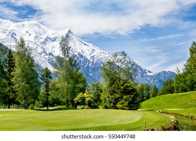 Golf course  over snow covered Mont Blanc in Chamonix, France.