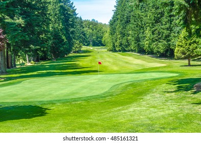 Golf course with red flag in a sunny day. Canada, Vancouver.