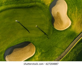 Golf course top view with players. Aerial view of golfers on putting green.