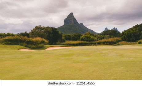 Golf course in tropical landscape, high mountain background. Mauritius, Tamarin.