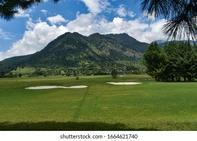 Golf course view with mountain background at Pahalgam Kashmir, india.We are now in the mountains and they are in us, kindling enthusiasm, making every nerve quiver, filling every pore and cell of us. - Shutterstock ID 1664621740