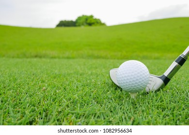 Golf Course where the turf is beautiful and Golf Ball on tee. Golf course with a rich green turf beautiful scenery.