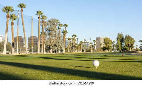 Golf course white balls spread all over grass in Encanto par, Phoenix downtown, Arizona in Winter; Copy space