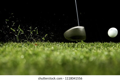 Golf driver hitting a golf ball to be shot on the green golf course.Golf is a club and ball sport in which players use various clubs to hit balls into a series of holes on a course in few strokes.