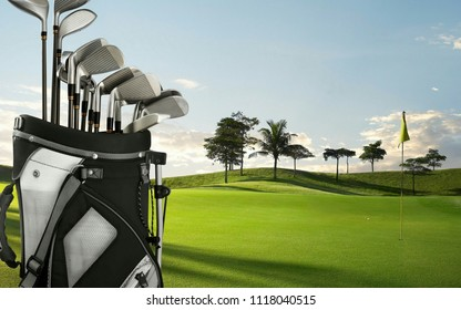 Golf drivers, putters on a golf bag on the green golf course.Golf is a club and ball sport which players use various clubs to hit balls into a series of holes on a course in few strokes as possible.