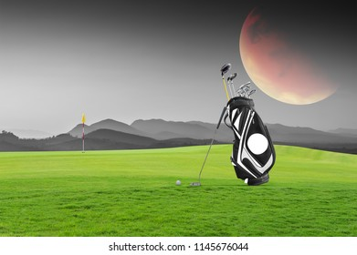 Golf equipment and golf bag , putter, ball on green at golf course the moon as  background.Elements of this image are furnished by NASA.