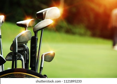 Golf equipment in beautiful golf course at sunset background.