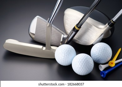 Golf equipment. Golf clubs, driver, iron, putter, balls and tees.