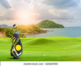 golf equipment on green and hole as background.