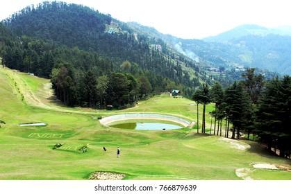 golf field at the kufri, shimla mountains, india