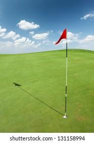 Golf flag on green grass