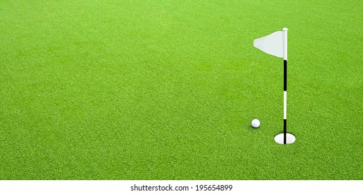 Golf flag on the green grass