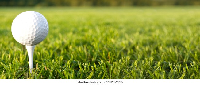 Golf game. Golf ball in grass.