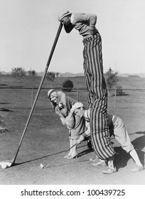 Golf game with man on stilts