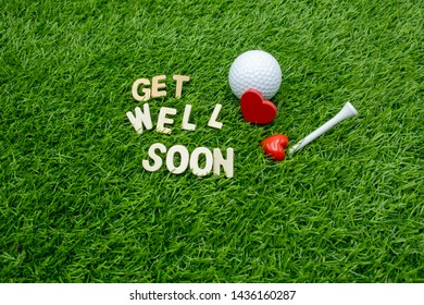 Golf get well soon with golf ball with love on green grass