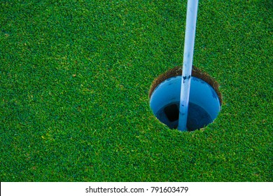 Golf Green Putting Cup with Flag Close Up