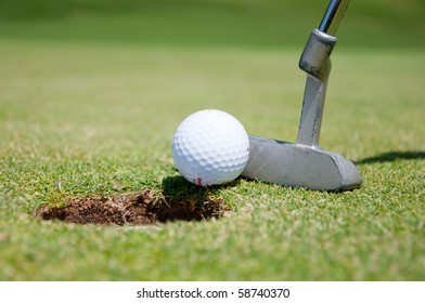 golf hole with ball and putt