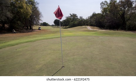 Golf hole with flag embroidered on the lawn.