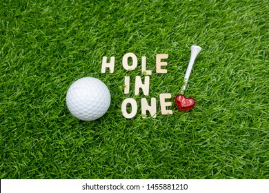 Golf hole in one is on green grass