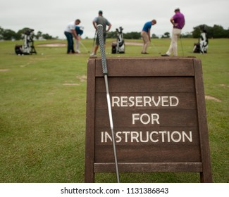 golf instruction taking place. Golf lessons. Reserved for a private session.