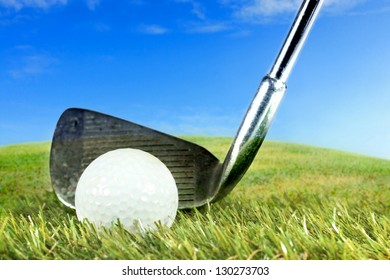 golf iron ready to hit the ball on green grass and blue sky background