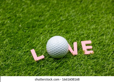 Golf with LOVE word on green grass
